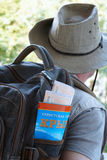 Tourist with a backpack,tourist map and train tickets. A man with a backpack and with hat.in the pocket of a backpack tourist map of Crimea and train tickets Royalty Free Stock Photography
