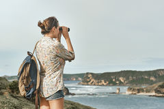 Tourist with backpacker and binoculars in hands enjoying view co royalty free stock photos