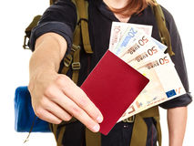 Tourist backpacker holding money and passport. Royalty Free Stock Photos