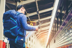 Tourist backpacker using map to travel at train station Stock Photography