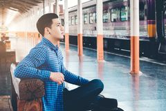 Tourist backpacker wait to travel at train station Stock Photography