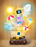 Tourist bag with colorful summer icons and symbols. On grungy background Royalty Free Stock Images