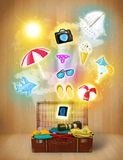 Tourist bag with colorful summer icons. And symbols on grungy background Royalty Free Stock Photo