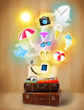 Tourist bag with colorful summer icons and symbols. On grungy background Stock Images