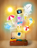 Tourist bag with colorful summer icons and symbols. On grungy background Royalty Free Stock Photo