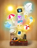 Tourist bag with colorful summer icons and symbols. On grungy background Royalty Free Stock Photos