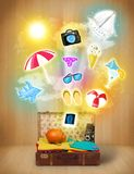 Tourist bag with colorful summer icons and symbols. On grungy background Stock Photography