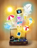Tourist bag with colorful summer icons and symbols. On grungy background Stock Photos