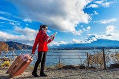 Tourist with baggage and map at Fuji mountain, Kawaguchiko in Japan.  stock image