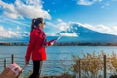 Tourist with baggage and map at Fuji mountain, Kawaguchiko in Japan.  royalty free stock photos