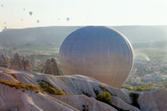 Tourist balloon on the valley of Cappadocia in Turkey Stock Images