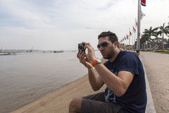Tourist at the bank of Mekong river Royalty Free Stock Image