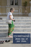 Tourist in bare feet as a mark of respect Royalty Free Stock Images