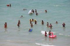 Tourist bath on the sea in El Arenal beach in Mallorca Stock Photos