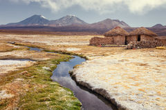 Tourist bathing in hot springs, Sajama national park, with volcano Parinacota and Pomerape in the background, Bolivia. Tourist bathing in hot springs, in a Royalty Free Stock Image