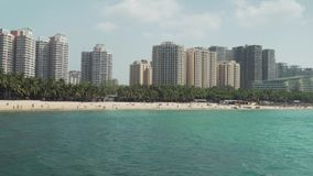 Tourist bay of Dadonghai on the island of Hainan on a hot spring day stock footage video stock footage