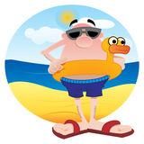 Tourist on the beach. Man on the beach with lifesaver shaped duck Royalty Free Stock Images