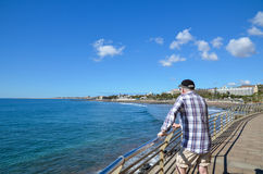 Tourist at the beach promenade by San Augustin at the Canary Isl Royalty Free Stock Photo