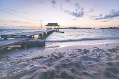 Tourist beach resort at dawn, marsala toned image Stock Photos