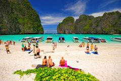 Tourist on the beach in south of Thailand Stock Photo