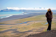 Tourist with beautiful Icelandic landscape behind Stock Images