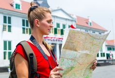 Tourist being lost in Jakarta, Indonesia. Woman got lost sightseeing with touristic map in Jakarta, Indonesia stock photo