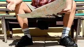 Tourist on a bench with the map stock video footage