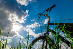 Tourist bicycle against the blue sky, clouds, sun Royalty Free Stock Images