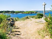 Tourist bicycle at viewpoint near Celtic cross. Travel to France - tourist bicycle at viewpoint near Celtic cross on Ile-de-Brehat island in Cotes-d'Armor Stock Images