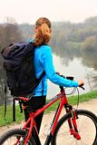 Tourist with bike and backpack Royalty Free Stock Photos