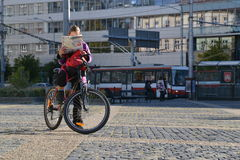 Tourist on bike looking in map. Tourist with his bike looking into map of Bratislava on Hodzovo namestie Bratislava, capital of Slovakia Royalty Free Stock Images