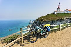 Tourist bike is parked on westernmost point of continent Europe. Stock Photo