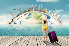 Tourist with bikini and the world landmark Stock Image