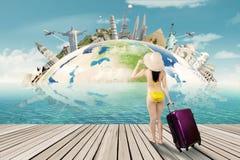 Tourist with bikini and the world landmark Stock Image