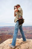 Tourist with binoculars Stock Image
