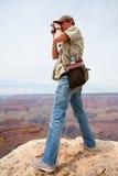 Tourist with binoculars stock image