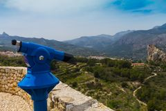 Tourist binoculars aimed at the road to the gorge of the mountains. Tourist backgraund. Tourist binoculars aimed at the road to the gorge of the mountains Stock Photography