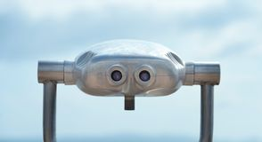 Tourist binoculars with blue sky background Royalty Free Stock Photo