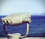 Tourist binoculars for exploring the seaside Stock Photo