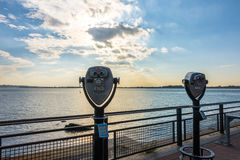 Tourist binoculars at Statue of Liberty, New York City , USA . Royalty Free Stock Images