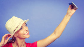 Tourist blonde woman taking pictures with phone Stock Photo