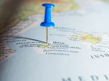 Tourist. Blue pushpin showing destination point on a map Stock Photos
