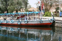 Tourist Boat. A tourist boat in Egypt; note the flat tyres royalty free stock image