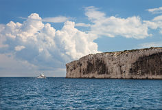 The tourist  boat against cliffs in Massif des Calanques Royalty Free Stock Image