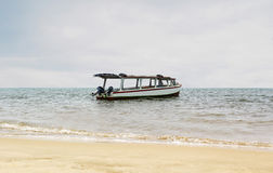 Tourist Boat Alone on the Beach. Many tourist from around the world visit Singapore and walking on the bridge royalty free stock photo