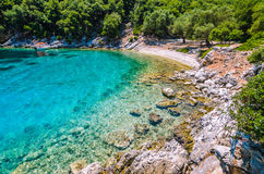 Tourist boat at anchor in a turquoise coloured bay, Kefalonia island, Greece Royalty Free Stock Photo