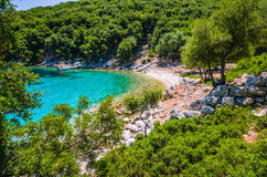 Tourist boat at anchor in a turquoise coloured bay, Kefalonia island, Greece Royalty Free Stock Photos