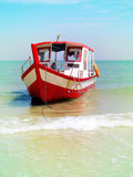 Tourist boat anchored on a beach in Thailand Stock Images