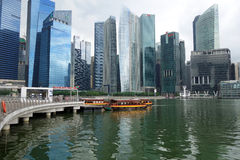 Tourist boat approaches the Raffles Landing Site in Singapore Stock Image