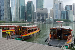 Tourist boat approaches the Raffles Landing Site in Singapore Royalty Free Stock Photography
